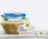 Laundry Basket with colorful towels on background - 238482814