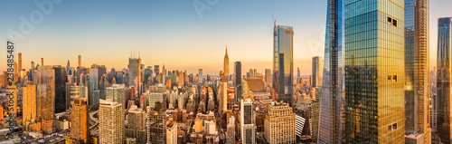 Foto Murales Aerial panorama of New York skyline above Hudson Yards midtown Manhattan skyscrapers on a sunny afternoon