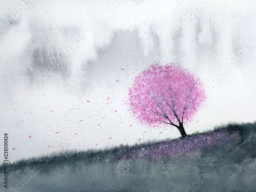 watercolor landscape pink tree cherry blossom or sakura  leaf falling to the wind in mountain hill with meadow field. traditional oriental ink asia art style.hand drawn on paper. © atichat