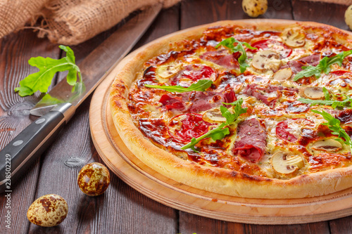 Delicious fresh pizza served on wooden table - 238502229