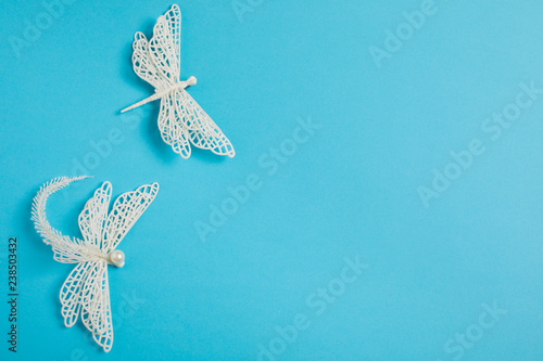 Christmas decoration white dragonflies on a blue background - 238503432