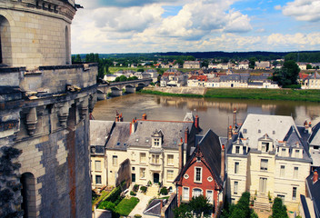 France. View of the royal castle of Amboise and the city on the banks of the Loire on a summer day.