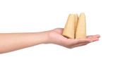 hand holding boiled bamboo shoots isolated on white background