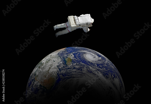 abstract wallpaper or astronaut flying in outer space near the earth . Elements of this image furnished by NASA f - 238538274