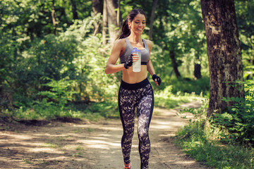 Young  woman jogging outdoor at the park on beautiful spring day.
