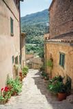 Valldemossa, Mallorca, Balearic Islands, Spain - July 21, 2013: View of the narrow streets of Valldemossa