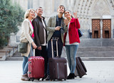 Two couples with baggage sightseeing and smiling - 238589883
