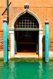 Gate of old venetian house in Venice,