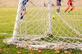Portería con red durante un juego de fútbol soccer