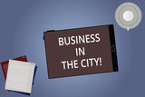 Conceptual hand writing showing Business In The City. Business photo showcasing Urban companies Professional offices in cities Tablet Screen Saucer and Filler Sheets on Color Background