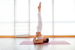 Leinwanddruck Bild - young woman practices yoga at  gym by window