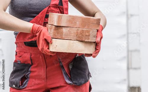Woman working with bricks - 238681461