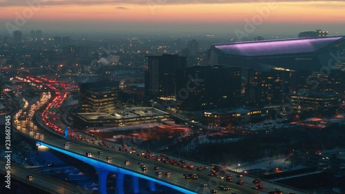 Aerial view of traffic on I35W Bridge and Downtown Minneapolis at sunset
