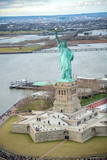 Overhead aerial view of Statue of Liberty from helicopter, New York City in winter - 238689292