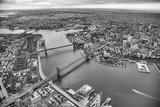 Aerial view of Manhattan and Brooklyn Bridge from helicopter, New York City in winter - 238689293