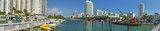 MIAMI - FEBRUARY 2016: Panoramic view of Miami Beach on a sunny day. The city attracts 15 million tourists annually - 238689424