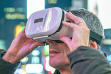 Man with Virtual Reality Visor in the city center surrounded by lights - 238689455