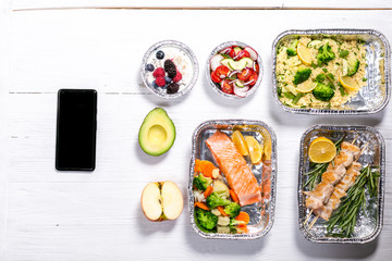 Healthy food delivery concept - meals in fossil containers, top view