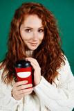 Beautiful woman holding disposable mug of coffee