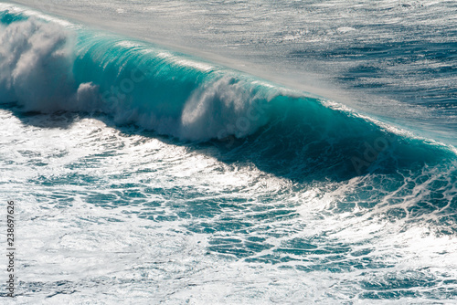 Waves breaking on the shore of Madeira island, Portugal