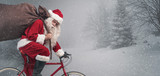 Santa riding a bicycle and carrying gifts