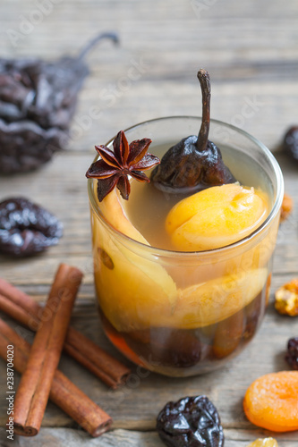 Leinwanddruck Bild Compote from dried fruits and spices on christmas winter time