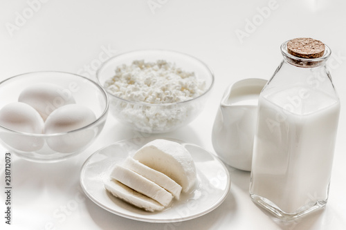 Healthy food concept with milk and cottage cheese on white table - 238712073