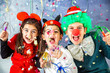 Leinwandbild Motiv Three kids celebrating Carnival  together at home