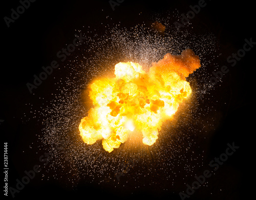Realistic fiery explosion with sparks over a black background © michalz86