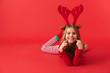 Cheerful little girl wearing Christmas raindeer costume