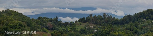 View of the mountains with sky and clouds above them. - 238715055