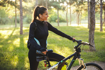 Attractive fit sportswoman with a bicycle