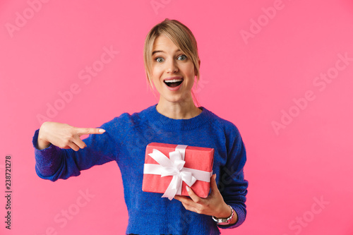 Cheerful young blonde woman wearing sweater - 238721278