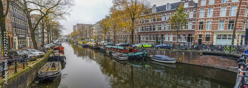 Amsterdam, Netherlands - main city and capital of the country, Amsterdam offers a splendid display of history and modernity, surrounded by the unique view of its canals - 238727223