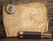 Old torn treasure map with compass and spyglass. Adventure and travel concept. 3d illustration.