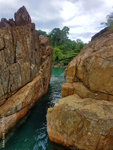 Beautiful rocky coast in Thailand. Vacation concept.