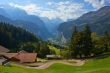 Mountain dramatic valley view with in village house in Wengen in Lauterbrunnen region in Switzerland.
