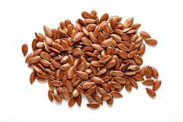 brown flaxseed isolated © MIGUEL GARCIA SAAVED