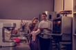 Positive pretty girls helping their mother in the kitchen