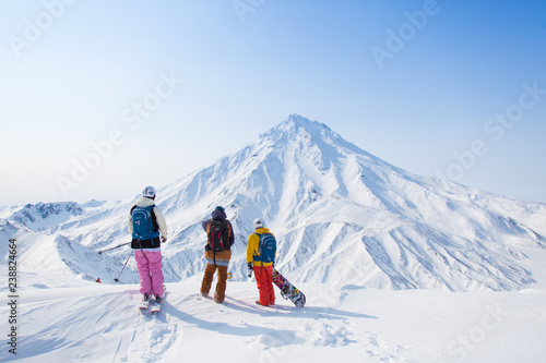 skiers in mountains