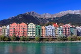 Beautiful colorful house buildings in front of beautiful mountains and blue sky in Innsbruck Austria