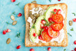 Leinwanddruck Bild - Toasts with feta cheese, tomatoes, avocado, pomegranate, pumpkin seeds and flaxseed sprouts. Diet breakfast. Delicious and healthy food. Flat lay. Top view