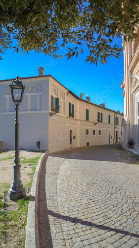 characteristic alley of Italian village with cobblestone street and lamppost. Amelia, Umbria, Italy - 238904853