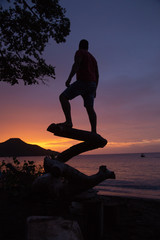 man watching sunset at costa rica beach © robcartorres