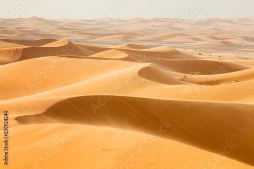 Leinwanddruck Bild waves from sand dunes in desert in Morocco