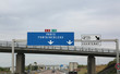 big road signs on the busy French highway to go to Paris and Fon