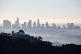 Hazy early morning view of downtown Los Angeles from popular Griffith Park above Hollywood, California.