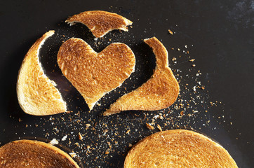Piece of fried bread in the shape of a heart and slices