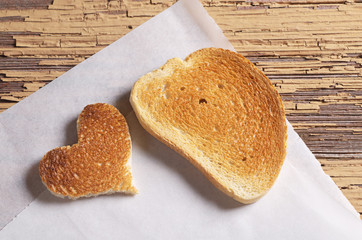 Roasted white bread with a heart-shaped
