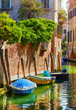 Venice, Italy. Boats, parked near brick walls of house